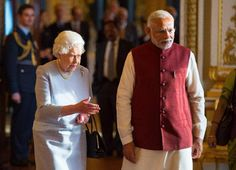 Britain's Queen Elizabeth II, left, guides Indian Prime Minister Narendra Modi at Buckingham Palace in London, on the second day of his visit to the UK, Friday Nov. 13, 2015.  Modi is in Britain for three days of cultural events and high level political and business meetings. (Dominic Lipinski  / POOL via AP)