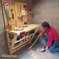 This simple wood work bench is perfect for a garage or utility room, and it takes up almost no floor space! : This simple wood work bench is perfect for a garage or utility room, and it takes up almost no floor space!