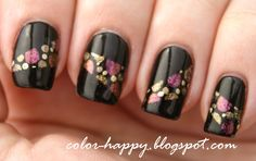"""""""This is Sally Hansen Xtreme Wear Black Out dotted with Hard Candy Beetle, Zoya Faye, Nabi Magnetic Candid (I think.  A lot of the polishes in the display were mislabeled.  This is a light khaki kind of gold) and China Glaze Passion."""""""