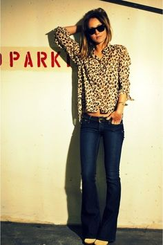 animal print blouse   flare jean. simple and chic