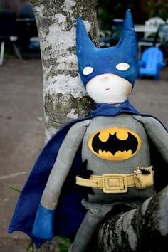 Batman doll I made for my son.  I used muslin, acrylic paint, and wool felt to sew and paint this one.  by Stephanie Schleicher