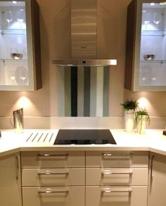 """This splashback is our """"Platinum"""" stripe and is shown on display at the Oxford Street branch of John Lewis. Oxford Street, Splashback, John Lewis, Kitchen Ideas, Kitchen Cabinets, Display, Glass, Collection, Home Decor"""