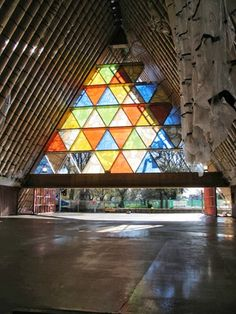 The 'Transitional Cathedral' is made of locally produced cardboard tubes of equal lengths.  Over 90 enormous 600mm diameter, 20 metre tubes form a triangular shape; and are protected by a polycarbonate roof above, and very solid concrete floor below. Sturdy LVL (laminated veneer lumber) inserted beams, lend further substantial support to these tubes. Since geometry is decided by plan and elevations of the original cathedral, there is a gradual change in each angle of paper tubes.