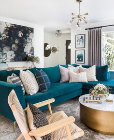 Teal Sofa + Brass & Marble Coffee Table + Large Scale Art + Modern Light Fixture + Rattan Accent Chair + Throw Pillows via west elm - Eclectic Glam Style In Seattle // Living Room Decor, Living Room Ideas, Decorating Ideas, Home Tour Teal Couch Living Room, Teal Sofa Living Room, Living Room Modern, Teal Living Rooms, Wallpaper Living Room, Trendy Living Rooms, Couches Living Room, Teal Living Room Decor, Living Decor