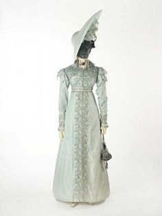 A pelisse or pelisse-coat, a kind of women's outer garment which could be made in everything from the lightest silk to heavy fur. It was worn over a gown but could look like a gown itself, especially when floor length like this garment. The pelisse was made for a trousseau in 1823 for the wedding of the grandmother of the donor. Production Date: 1823