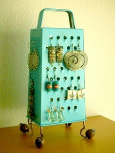 """Display your earrings on an old cheese grater."" 
