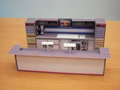 In Pedelmann`s page you will find this cool bar in 1/32 scale, perfect for Slot Car scenaries, but you can change the size with Photoshop or MsPaint and build it in 1/87 (HO scale), etc. In the site you will find the building (exterior) of this bar too. You have three kinds of bar: Old Fashioned, Red Bull`s or Modern.