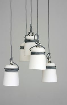 Ceramic pendant lamps suspended from cloth-covered cable for a nautical look (from Folklore)
