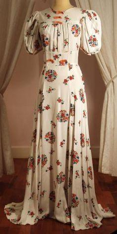 Vintage cream floral bias cut long dress orange bows women's vintage fashion clothing history for spring summer 1930s Fashion, Retro Fashion, Vintage Fashion, Pretty Dresses, Beautiful Dresses, Pretty Clothes, Vintage Dresses, Vintage Outfits, Vintage Clothing