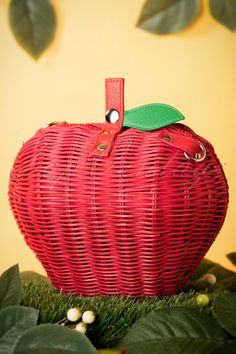This 50s Juicy Apple Wicker Bag in Redis deliciously sweet looking!An apple a day keeps the doctor away! This playful retro apple bag is made from red woven straw with green faux leather details and comes with a long, adjustable handle so you can playfully wear her over your shoulder. Are you taking your daily vitamins? Then this cutie is a good start for a healthier life ;-)   Silver toned push-button closure One open compartment Fully lined with a fun polkadot print Long, detachable…