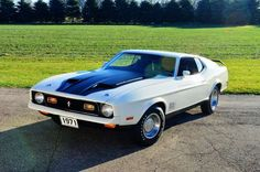 1971 Ford Mustang Mach 1- indeed a factory 429 Super Cobra Jet. An oil cooler was not part of the Mustang's 1971 Drag Pack package, which elevated a CJ to an SCJ. We had already noticed the ram air and that the fifth character of the VIN is J. All J-codes are 429 Cobra Jets with ram air. None of the C-codes in 1971 were ram air cars, but either J or C could have the Drag Pack.