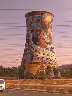 Cooling Tower,Soweto dropped inside the tower-bunjee jumping. Banksy, Art Du Monde, Cooling Tower, Out Of Africa, Water Tower, Jolie Photo, Art Graphique, Street Art Graffiti, Public Art