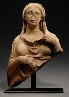 HELLENISTIC MARBLE HALF-STATUE OF A GODDESS, PROBABLY PERSEPHONE    Or possibly Demeter, wearing a chiton, her himation over her head (capite velato).    Asia Minor, ca. 325-250 BC