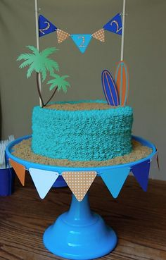 Jake's surfboard and bunting cake.