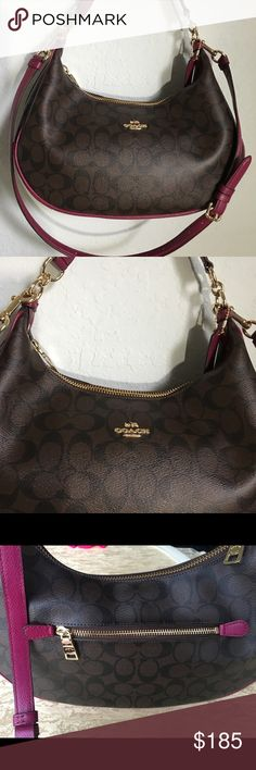 Coach Hobo Signature Brown Shoulder handbag Beautiful Coach Hobo handbag has adjustable strap. Signature style with fuchsia leather highlights. Zipper closing and zipper inside was th pockets. New with Tags. Coach Bags Shoulder Bags