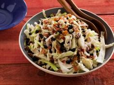 Red, White and Blueberry Coleslaw : Crispy bacon, dried blueberries and thinly sliced cabbage turn basic coleslaw into a colorful and patriotic side dish.