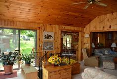 Chez Chateau Gai Cottage has knotty pine ceilings and sliding doors that open to a large sundeck overlooking Little Wolf Lake.