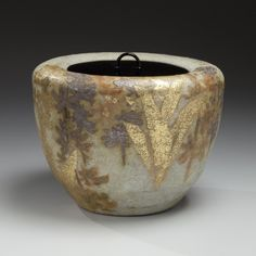 Kiyomizu Rokubei VI (Japanese: 1901–1980) - Mizusashi (water jar) with floral patterning of an ebine (calanthe orchid) and lacquer lid ca. 1978 - Glazed stoneware with gold and silver