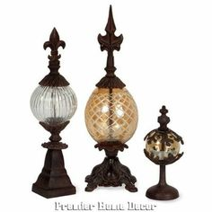 Tuscan St/3 Fleur De Lis Accent Finials Metal & Glass... A great decorative element for an office or living room bookshelf! Set of three brown iron and hand-blown glass finials with fleur-de-lis tops!