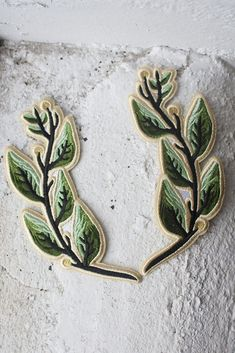 Embroidered laurel patches with iron-on backing can be used to frame and complement your other favourite patches - perfect on the back of a jacket! Each laurel