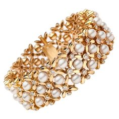 1960s Tiffany & Co. Pearl Diamond Gold Floral Link Bracelet. A Fantastic Vintage Tiffany & Co. 18Kt Yellow Gold Bracelet with Floral Links Detailed in 5.5 to 6.0mm Round Cultured Pearls and 75 Round Brilliant Cut Diamonds Totaling Approximately 2.37 Carats. The bracelet measures 7.5 inches long and 0.88 inches wide. The piece totals 86.1 grams.