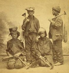 A studio portrait of four Afro-American climbing boys from New York, with brushes and scrapers, Two are standing and two are kneeling. They look between eleven and fourteen years old, wear rough clothes and battered hats and caps. London History, British History, Tudor History, Ancient History, Historical Women, Historical Photos, Asian History, Black History, Vintage Photographs