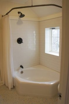 For when we remodel the bathroom - love the combo jetted tub and shower idea. Double curtains and bronzed bar make it perfect. Would love to have either a tile/beadboard surround or a little bit of ledge on one side for candles/soaps, etc.