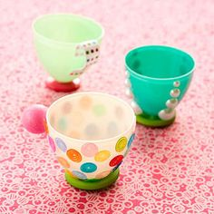 Turn plastic Easter eggs into Tiny Teacups! These little cups are perfect for pretend tea parties. Attach a button base to a plastic egg half with a glue dot or hot glue. Then use glue dots to attach sequins, ribbon, or other decorations, or use self-adhesive gems.