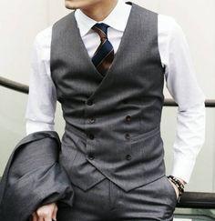 Classic three piece suit and white custom dress shirt