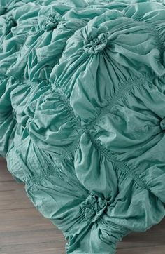 Trending now: Blue ruched knots comforter