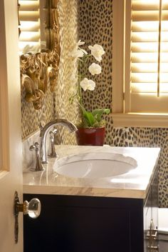 Glam leopard bathroom. Also love that mirror & door knob!