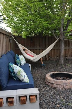 Magical Backyard Makeover DIY Fire-pit, bench, hammock and solar paneled lights Click to read more