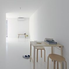 All-white interior. The D-Apartment by Japanese architects Spacespace. One of the benefits of an all-white space is natural emphasis on the beautiful play of light.
