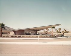 Historic photo of the Tramway [Enco] Gas Station, now the Palm Springs Visitors Center, toured by Friends of Architecture Palm Springs tour participants, 2008 [designed by Albert Frey and Robson C. Chambers] #friendsofarchitecture #architecture #palmsprings