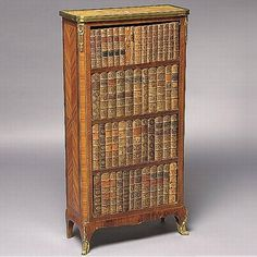 A LOUIS XV/XVI TRANSITIONAL STYLE SMALL BIBLIOTHEQUE, EARLY