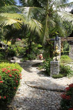 Boomerang Village Resort Phuket. Surrounded by lush vegetation and tropical plants.