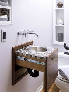 15 Hideaway Storage Ideas for Small Spaces Pull out sink Recessed shelving