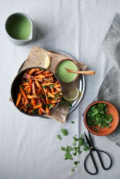 healthy oven-baked sweet potato fries served with a divine tangy, garlicky herbed tahini sauce