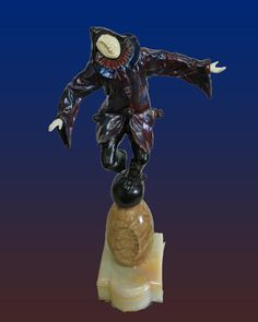 Amazing Chiparus Clown on a Ball Demetre Chiparus. 22 inches. Bronze and marble. Includes certificate of authenticity.