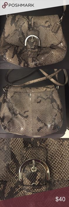 "Coach Leather Exotic Python Flap Crossbody NWOT Coach Soho Leather Exotic Python Flap Swingpack Crossbody Bag Handbag Style 45648, New without tags -Color: Python Black/Grey -Flap With Magnetic Snap Front Closure -Buckle Detailing says Coach  -Fully Fabric Lined Interior -One interior Back Wall zip compartment  -Genuine Leather with Python Embossing  -Coach Python Embossed Hangtag  -Polished Nickel Hardware -47"" Leather Crossbody Strap -Measures Approx 8.5"" (W) x7.5"" (H) x 3"" (D) Coach Bags…"