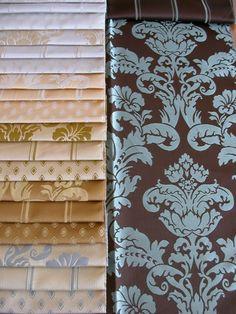 Klasszikus mintájú szövött bútorszövet. Szinek: fehér, fehér–arany, arany–bézs, arany, barna–arany, kék–arany