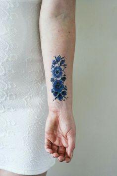 Beautiful blue flower tattoo