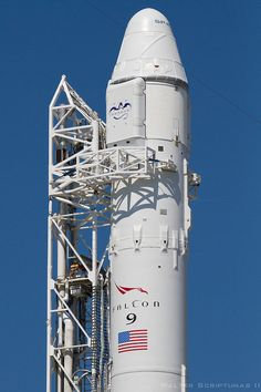 The SpaceX Falcon 9 rocket and Dragon capsule stand poised for launch at complex 40 at Cape Canaveral.