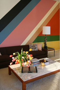 Via apartmenttherapy.com - I just love the bold colors and angles here. I need to find a rental that will let me paint!