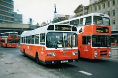 Two proper buses - including a 261 outside Piccadilly Plaza.