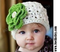 i love little crocheted hats... esp with flowers