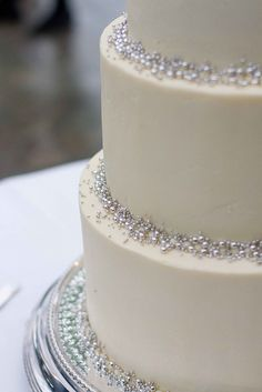 Simple white wedding cake with silver accents