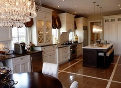 Contrasting cabinets and island and counters