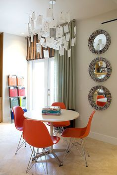 Orange Eames Eiffel  chairs... love.  Want in breakfast nook with white tulip or odyssey table.