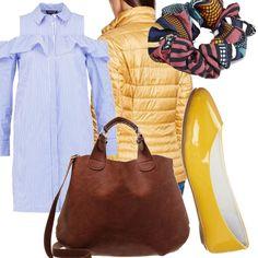 Super camicione a righe azzurre e bianche abbinato alla splendida ballerina gialla lucida. Portiamo con noi il piumino leggero giallo, leghiamo i capelli con l'elastico e abbiniamo la bellissima borsa color cuoio.